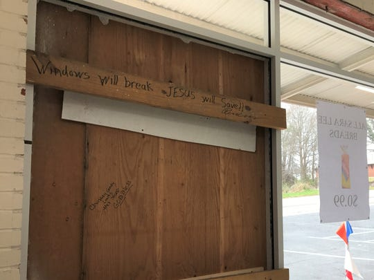 Whitner Street Grocery owner Cindy Vernier is encouraging people to sign the inside of a boarded-up window after a burglary Tuesday night.
