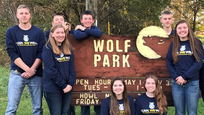 Columbus FFA members at the Wolf Park one of many tours they took on their trip to National FFA Convention.  Pictured: From left,  Kyle Paulson, Lacey Schleicher, Will Kessenich, Garret Baerwolf, Hailey Schoenherr, Abbygail Hayes, Colin Damm and Sydney Moore.