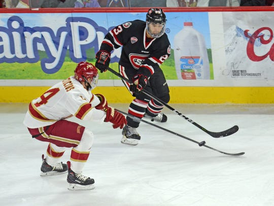 St. Cloud State's Robby Jackson tries to get the puck