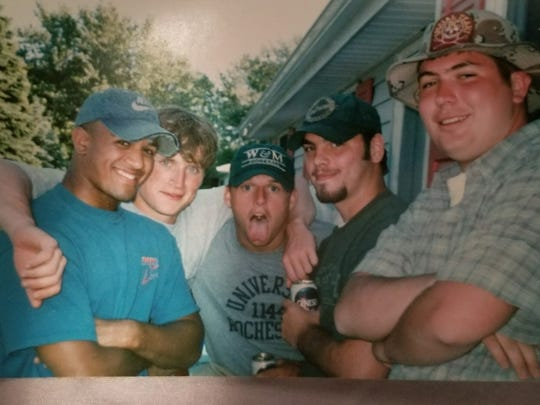 Brian Daboll (center, tongue out) hanging out with friends following his graduation. Hilton's Jeff Smith is on the far left.