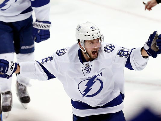 Tampa Bay Lightning right wing Nikita Kucherov (86) celebrates a goal by Ondrej Palat against the Detroit Red Wings in the third period of Game 4 of a first-round NHL Stanley Cup hockey playoff series Thursday, April 23, 2015, in Detroit. (AP Photo/Paul Sancya)