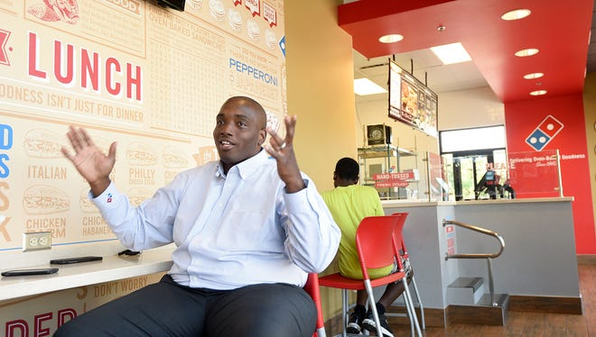 Anthony Satterwhite talks about owning several Domino's franchises in the Mansfield area Thursday from his Lexington Avenue location.
