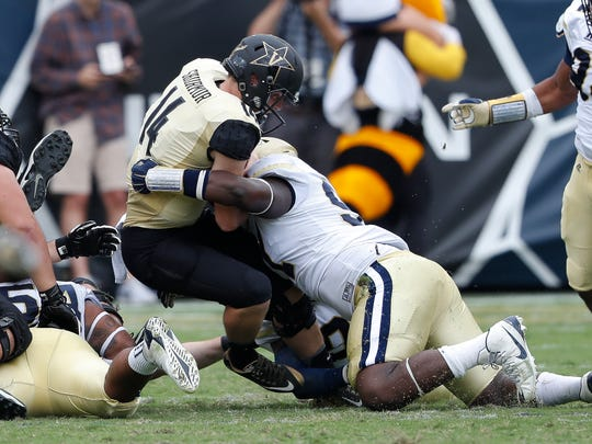 Vanderbilt quarterback Kyle Shurmur (14) is sacked by Georgia Tech defensive lineman Patrick Gamble (91) in the second half of an NCAA college football game Saturday, Sept. 17, 2016, in Atlanta. Georgia Tech won 38-7.