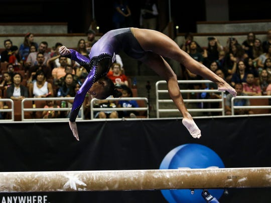 Trinity Thomas competes on the balance beam during senior women's opening round of the U.S. gymnastics championships, Sunday, Aug. 20, 2017, in Anaheim, Calif. (AP Photo/Ringo H.W. Chiu)