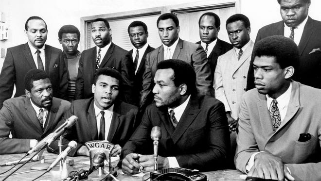 Former Cleveland Browns Hall of Fame running back Jim Brown presides over a meeting of top black athletes who supported boxer Muhammad Ali's refusal to fight in Vietnam on June 4, 1967.  Pictured: (front row, from left) Bill Russell, Muhammad Ali, Jim Brown, Lew Alcindor; (back row) Carl Stokes, Walter Beach, Bobby Mitchell, Sid Williams, Curtis McClinton, Willie Davis, Jim Shorter, and John Wooten.