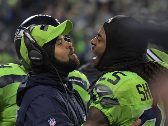 Dec 15, 2016; Seattle, WA, USA; Seattle Seahawks cornerback Richard Sherman (25) is restrained by defensive coordinator Kris Richard in the third quarter against the Los Angeles Rams during a NFL football game at CenturyLink Field. Mandatory Credit: Kirby Lee-USA TODAY Sports
