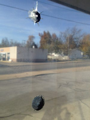 Two BB holes are visible in a window of the Unitarian Universalist Fellowship of Mountain Home building. While some Internet sites have claimed the vandalism and a piece of hate mail a parishoner received are related, authorities and the victim say they don't believe that's the case.
