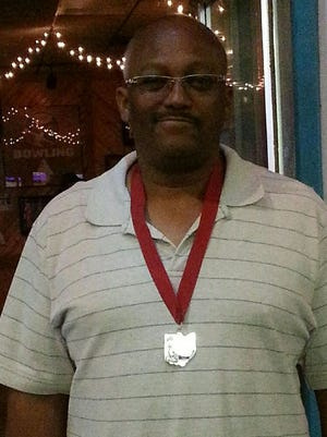 Edward Luckett poses with his silver medal after bowling a 592 series in Columbus, June 20, 2016, to qualify for the National Senior Games to be held June 2-15, 2017 in Birmingham, Alabama.