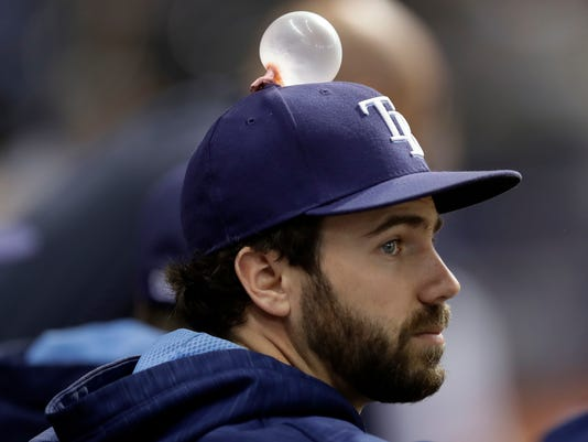 Tampa Bay Rays pitcher Austin Pruitt has a bubble gum bubble on top his hat during the eighth inning of a baseball game against the Minnesota Twins on Monday, Sept. 4, 2017, in St. Petersburg, Fla. Rays' pitcher Chris Archer was behind the prank. (AP Photo/Chris O'Meara)