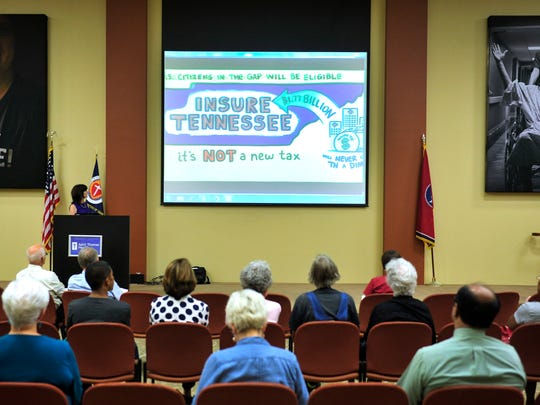People watch a short video about Insure Tennessee during