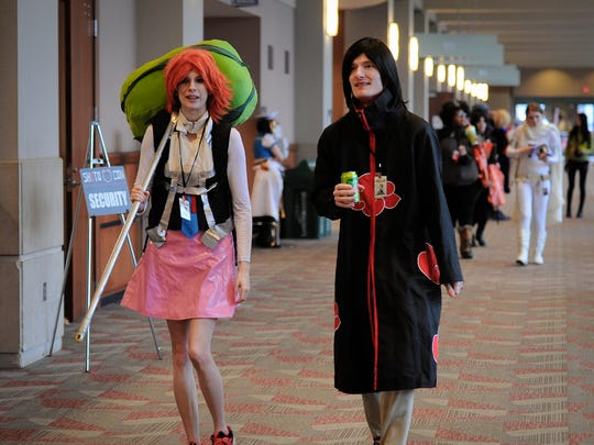 Anime aficionados dressed as their favorite characters