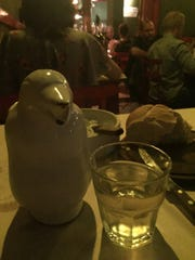 Wine in a penguin pitcher.