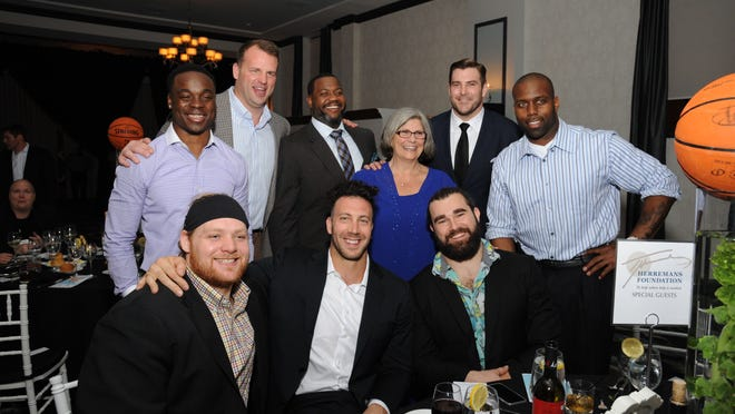 Connor Barwin (front row, center) and Jason Kelce (front row, right) pose with Eagles teammates.