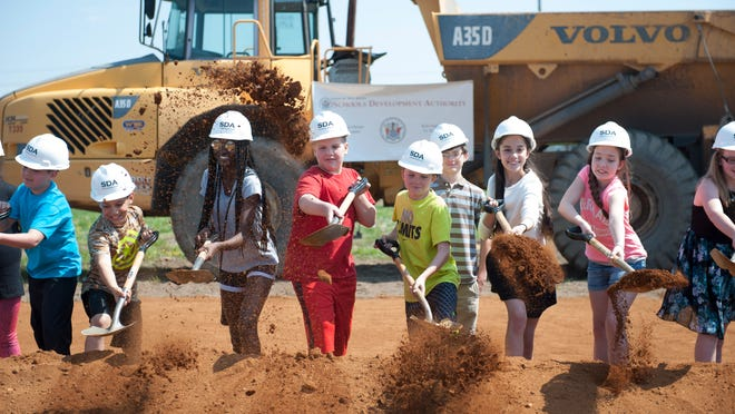 Mary Ethel Costello students shovel dirt during the groundbreaking ceremony for the Gloucester City Middle School. Monday, May 4, 2015.