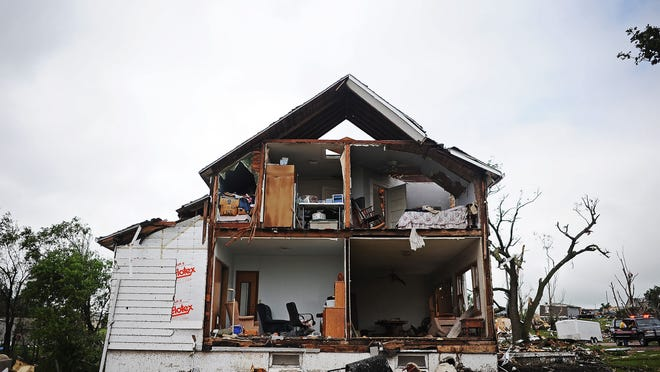 A damaged home is seen in Wessington Springs on June 19, 2014, after a tornado tore through the area the previous night. More than 20 homes were destroyed in the town of about 1,000.