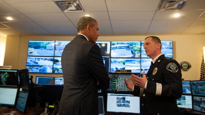 President Barack Obama tours the Real-Time Tatical Operational Intelligence Center in the Camden County Police Administration Building with Camden County Police Chief Scott Thomson as President Obama visits Camden on Monday (Chris LaChall/Courier-Post) POOL