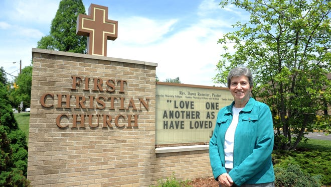 Rev. Dawn Remster poses for a photo outside First Christian Church, located at 3000 Dresden Road. The month of May marks 145 years of service for the church.