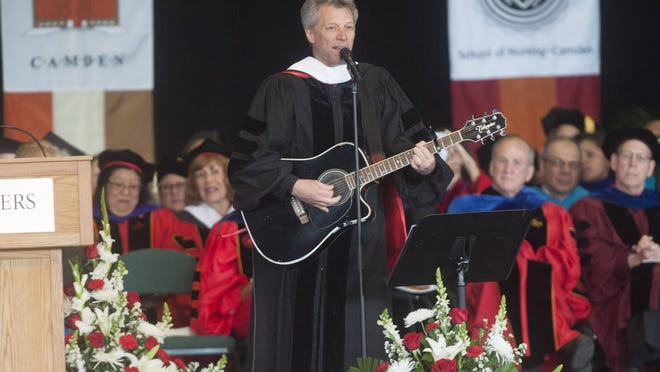 Jon Bon Jovi performs after receiving an honoray doctorate degree during Rutgers-Camden's commencement at the Susquehanna Bank Center in Camden Thursday.