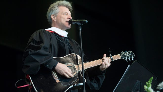 Jon Bon Jovi performs on stage after receiving an Honorary Doctor of Letters degree during Rutgers-Camden's Convocation and Graduate Commencement at the Susquehanna Bank Center in Camden. Thursday, May 21, 2015.
