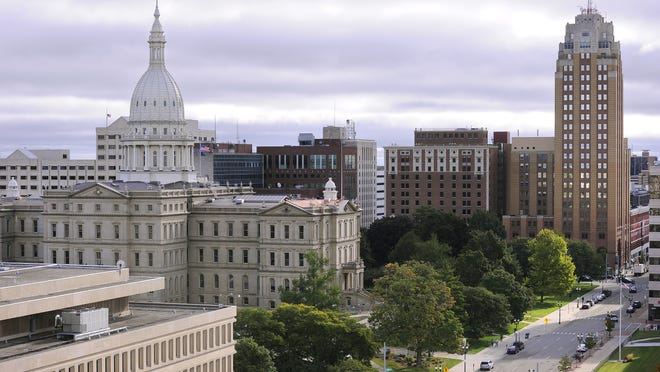 The Capitol building, Boji Tower, and other buildings in downtown Lansing are seen in this September 2014 Lansing State Journal file photo. Lawmakers are working on a 2016 budget that includes $3.2 million in savings to come from the closure or consolidation of 15 Department of Health & Human Services offices around the state.