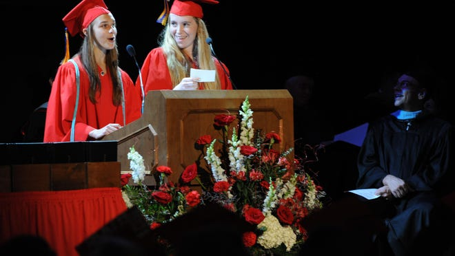 After dropping and mixing their not cards, valedictorian Olivia Newman, left, and salutatorianSarah Cooper turn their addresses into a comedy duet to the enjoyment of those attending Lafayette Jefferson's graduation ceremony Sunday.