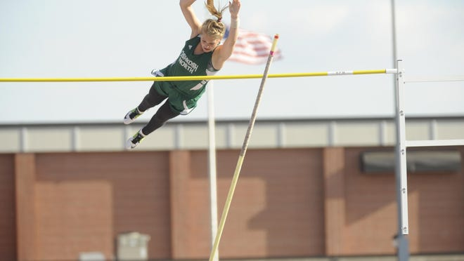 Oshkosh North's Erin Neveau clears the bar at 11 feet during the Division 1 pole vault competition at the WIAA State Track and Field Meet on Friday.