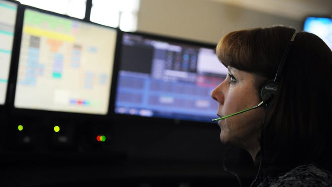 Diane Sweet at her dispatch station at Monterey County Emergency Communications in Salinas.