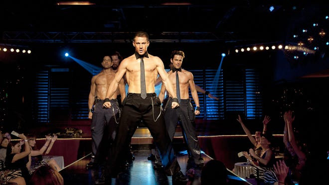 "This film image released by Warner Bros. shows, from left, Adam Rodriguez, Kevin Nash, Channing Tatum, and Matt Bomer in a scene from ""Magic Mike."""