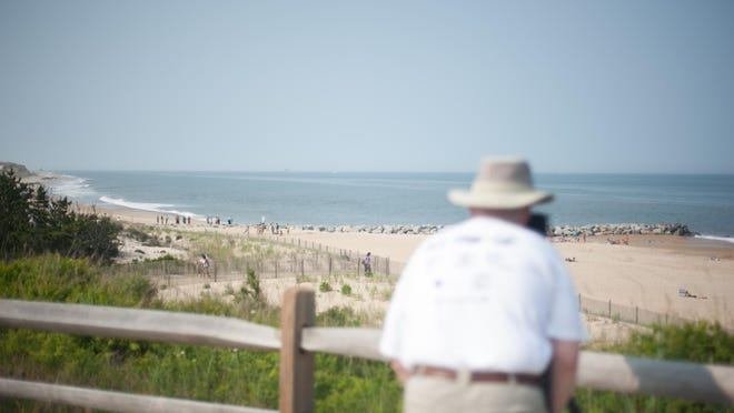 A photographer takes a photo at Herring Point at Cape Henlopen State Park.