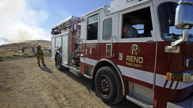 A Reno fire engine is positioned to protect structures from the Chocolate Fire in Sun Valley on Thursday, August 11, 2011.
