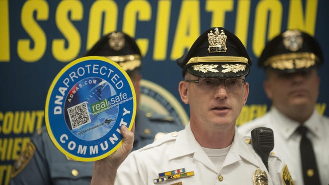 Gloucester Township Police Chief Harry Earle unveils a DNA-based marking system from Applied DNA Sciences that will allow the public to protect personal property from thieves. Tuesday, June 16, 2015.