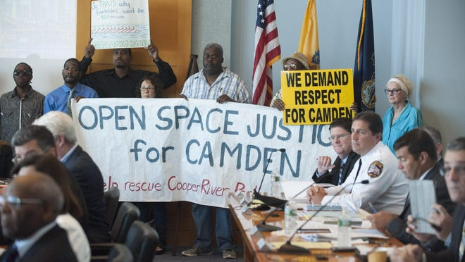 Demonstrators who want Cooper River Park West on Admiral Wilson Boulevard in Camden protested during the DRPA board meeting. Wednesday.