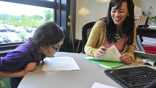 Bianca Jones talks with third-grader Emily Ceron at Rocketship Nashville Northeast Elementary in Nashville. In its first year, the school had about 450 students.