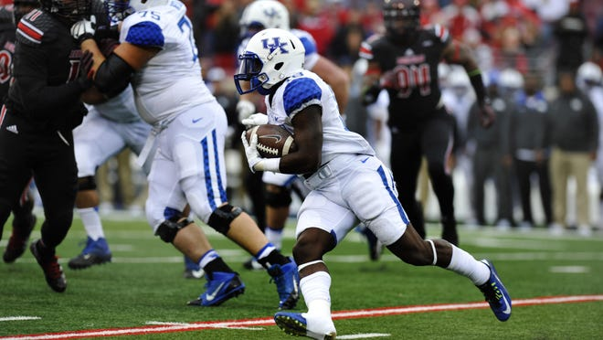 UK's Stanley 'Boom' Williams runs for a big gain in the second half of a game against Louisville on Nov. 29.