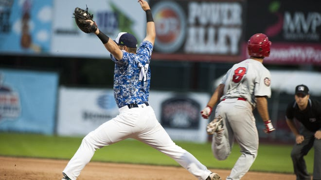 Lake Monster's Chris Iriart (18) stretches to catch the ball for an out during the baseball game between the Auburn Doubledays and the Vermont Lake Monsters at Centennial Field on Wednesday night July 22, 2015 in Burlington, Vermont.
