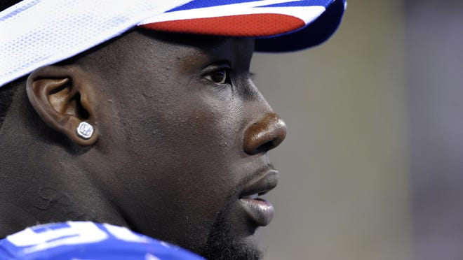 """The Giants finally have spoken with defensive end Jason Pierre-Paul, shown here during a 2014 preseason game against New England, about his injuries. Giants general manager Jerry Reese said Monday morning, Aug. 3, 2015, in a radio interview that """"it was a personal conversation, and I want to keep it private between him and I."""""""