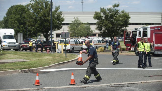 Emergency personnel secure the scene of a gas leak at a demolition stie on Woodcrest Rd. in Cherry Hill. A contractor working to demolish the former Victory Refrigeration plant on Woodcrest Road near Burnt Mill Road hit a PSE&G gas line at the complex. Friday, August 7, 2015