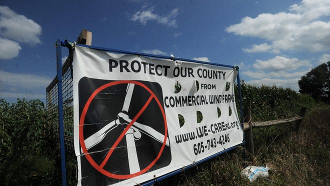 A sign against commercial wind farms in Lincoln County off of Hwy 18 near Canton on Thursday. Dakota Power Community Wind wants to put 500 wind turbines up in the state.