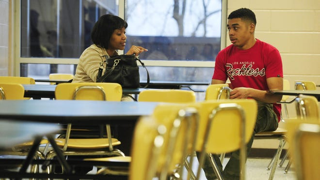 Mentor Danielle Wright talks with Xavier Scott after a Tennessee Promise meeting at Gallatin High School.