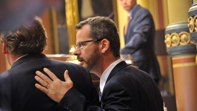 Todd Courser tells Rep. Ed McBroom, who chaired the panel that recommended ousting him, that he will resign instead of waiting for a third vote.