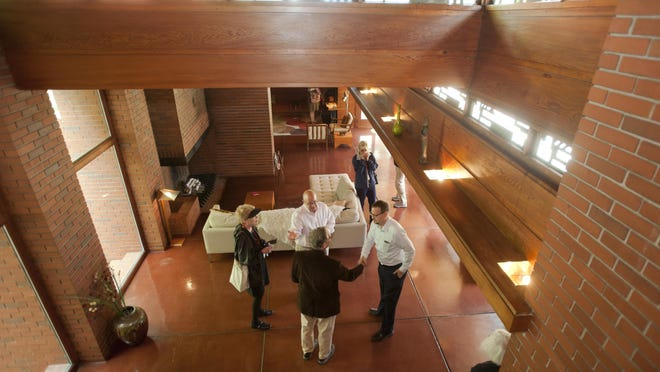 Brothers Michael and Gary Ditmer, center left and right, owners of Still Bend, welcome members of the Frank Lloyd Wright Building Conservancy on Wednesday, Sept. 30, in Two Rivers.