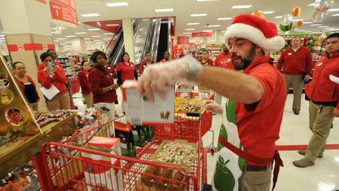 Black Friday preparations in 2013 at a Washington D.C. Target store. Target store assistant manager Matt Roy prepares holiday snacks for staff to sample during a morning huddle. Photo by H. Darr Beiser, USA TODAY Staff.