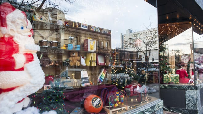 Winston Publishing and Gallery plans to win the holiday window display contest.