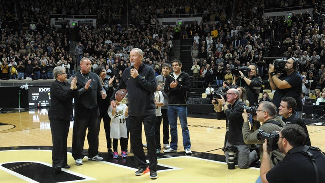 Rick Mount, syurrounded by his wife Donna, family and a host of media tells a standing crowd at Mackie Arena of his days at Purdue.