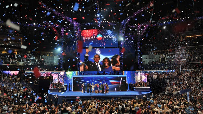 The Obama and Biden families celebrate on the last night of the 2012 Democratic National Convention in Charlotte. (Evan Eile, USA TODAY)