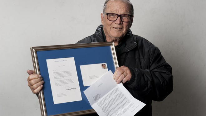 George Fry holds Nancy Reagan's framed response from November 2012 to his wife Connie Fry's letter.