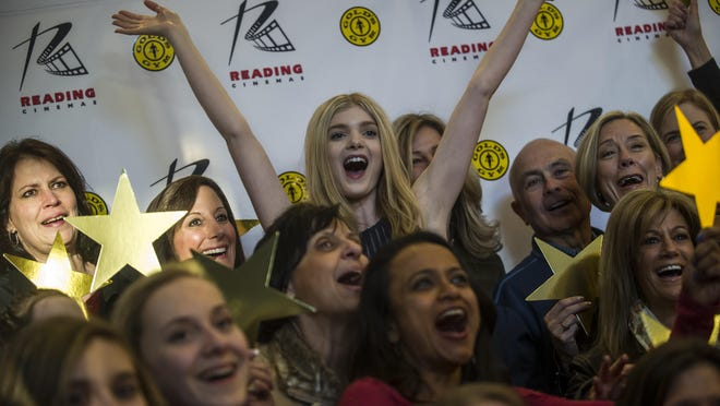 """Elena Kampouris, a Bridgewater-raised actress who stars in """"My Big, Fat Greek Wedding 2,"""" poses for a photo with family members at the Reading Cinemas in Manville on March 25, 2016."""