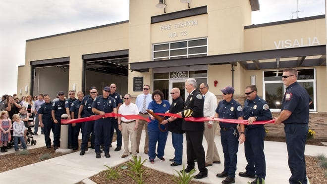 Visalia City Council members, Visalia City Fire Chief Doug McBee and firefighters lead a ribbon cutting ceremony for Station 53 on Wednesday, April 6, 2016. Construction for the new station on Walnut Avenue just east of Akers Street began in February of 2015.