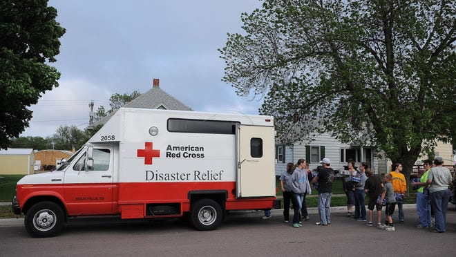Volunteers load up an American Red Cross Disaster Relief vehicle with food, water and other supplies on Sunday, May 10, 2015, outside Tripp-Delmont School in Tripp, S.D. A tornado tore through the town of Delmont, S.D., near Tripp damaging homes and businesses on Sunday morning.