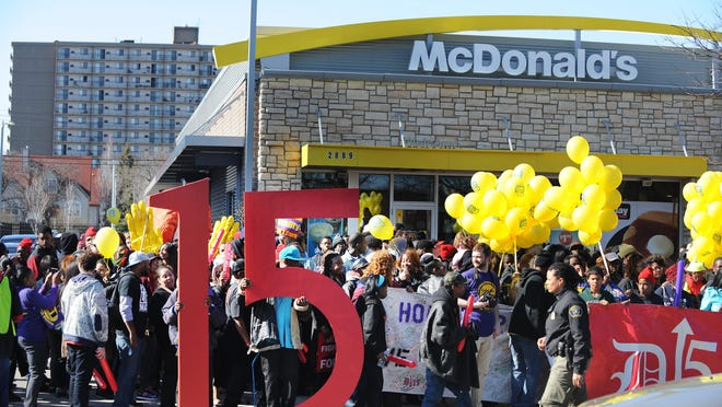 Hundreds of protesters advocate for a minimum wage hike to $15 an hour from the sidewalk in front of the McDonald's on W. Grand Blvd. in Detroit on Thursday.